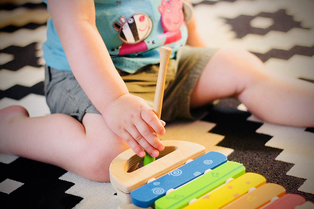 creative musical play with xylophone